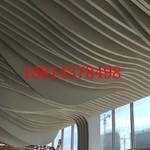 大廳造型斷隔吊頂木紋鋁方通弧形